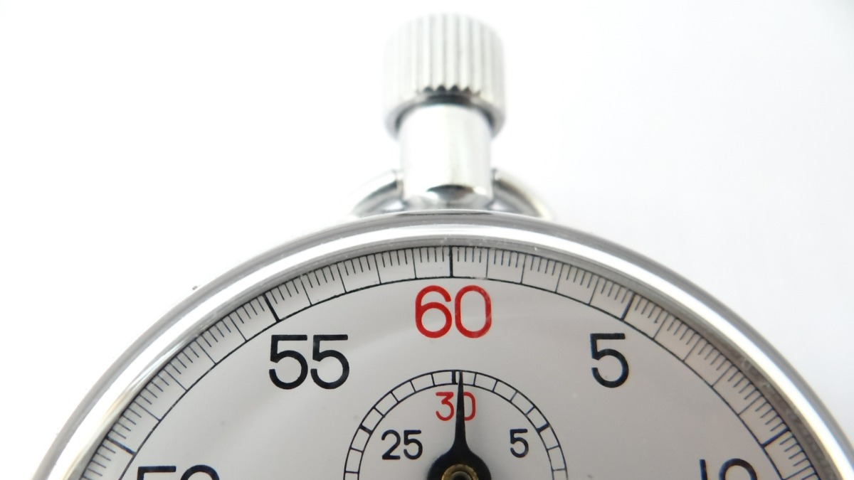 A partial view of a stopwatch timer as it ticks.