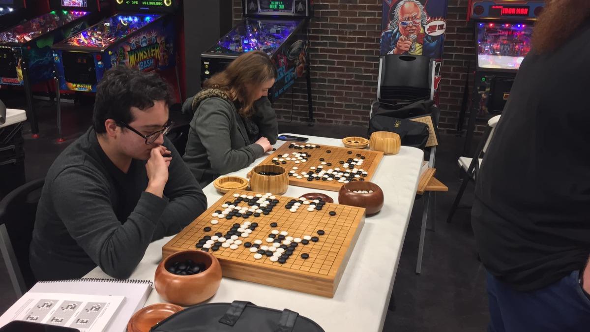 Jamie Cayley plays mathematician's game Go at Southwest Missouri Go Club.