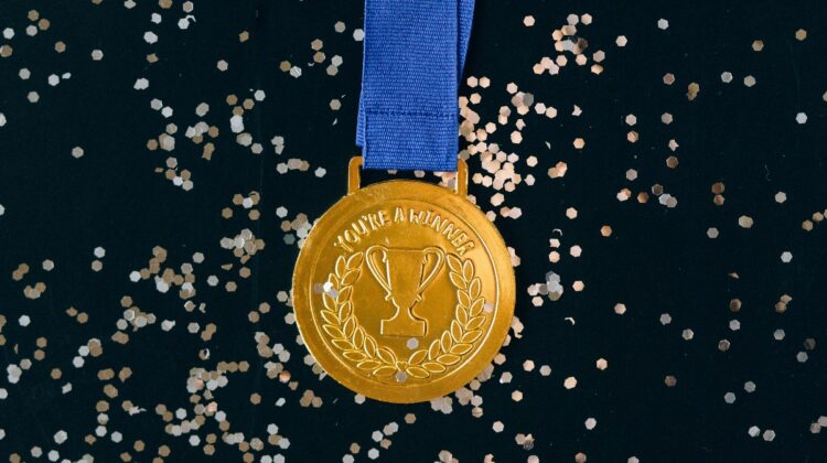 "An award medal with the label ""Winner."" Photo by Nataliya Vaitkevich from Pexels."