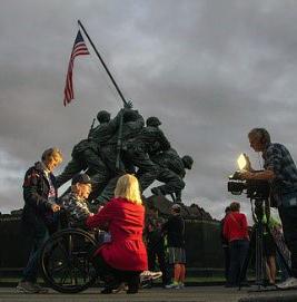 Reporter Susan Hiland interviewing veteran.