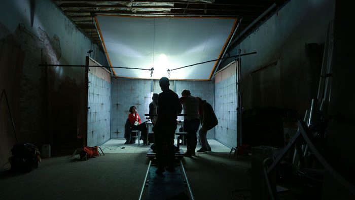 Crew set up the interrogation room for the film Counting to 1000