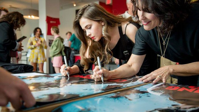 Cailee Spaeny and Teri Austin sign posters at premiere of Counting to 1000 at the Moxie
