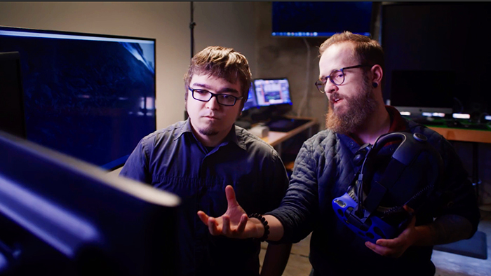 """Still from promotional video """"Take Your Shot"""" shows a professor instructing a student about virtual reality development"""