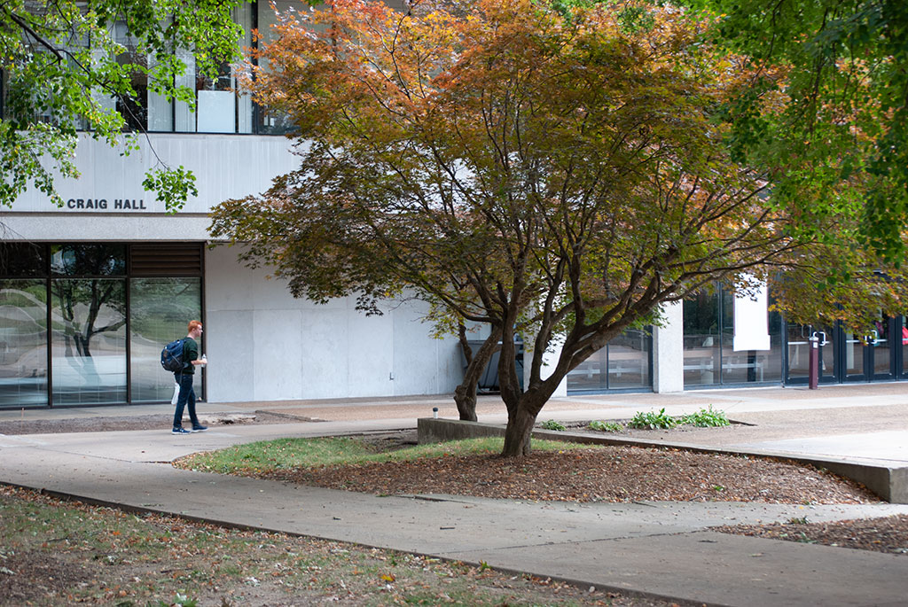 Student walks by Craig Hall on campus of Missouri State University