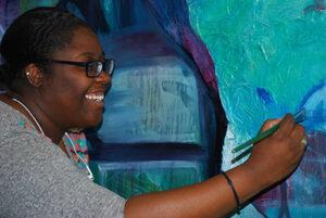 Student Alexis paints