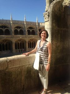 Photo of Etta Madden standing in front of old-looking architecture (Photo Credit: Etta Madden)