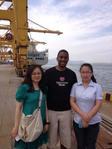 Rowey and two KN Logistics employees at the intermodal shipping port in Dalian, China