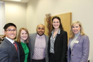 Amir Windom (center) with COB Associate Dean Dr. Rozell (right) and three COB graduate students at the luncheon.