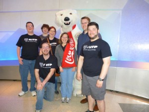 AITP students pose with Coca Cola Polar Bear at Coca Cola world in Atlanta