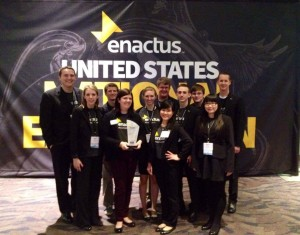 team members pose with trophy