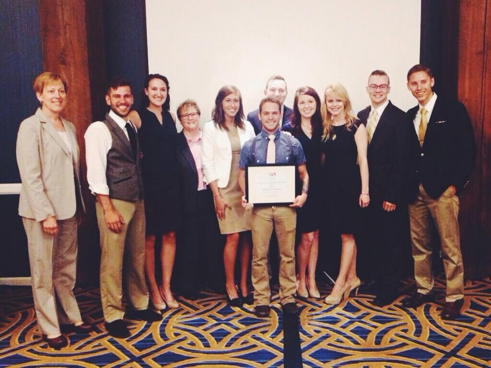 Ad Team students standing with Linda Rozett, Vice President Communications, American Petroleum Institute