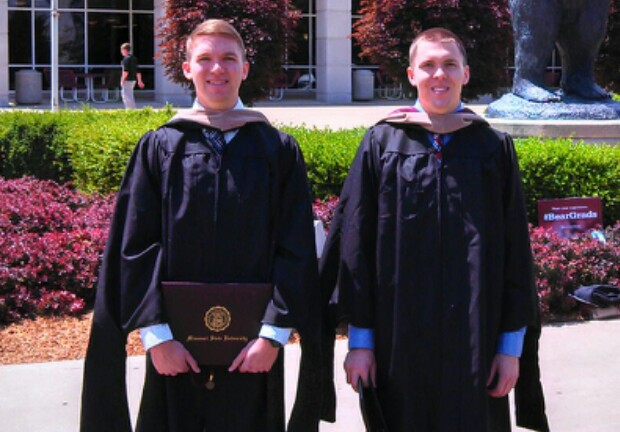 Collin and Colby Geringer stand outside after graduation