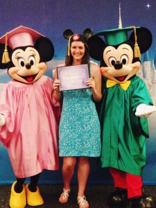 Ashley in graduation cap with Mickey and Minnie Mouse also in graducation caps