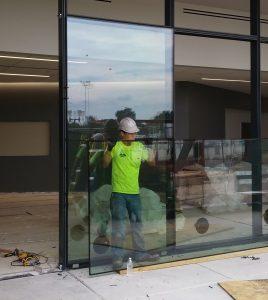 Installation began on exterior glass walls on August 26.