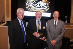 Michael Hammond, center, receives his Outstanding Educator Award from Jim O'Hallaron, President & CEO of the Missouri Society of Certified Public Accountants, pictured left, and John Lindbloom, Chair of the Missouri Society of Certified Public Accountants, pictured right.