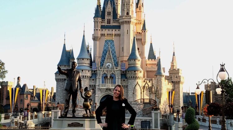 Woman standing in front of castle at DisneyWorld.