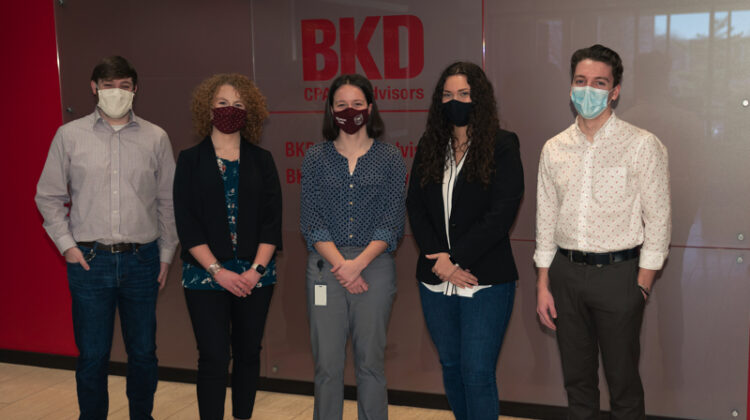 Five students with face masks on.