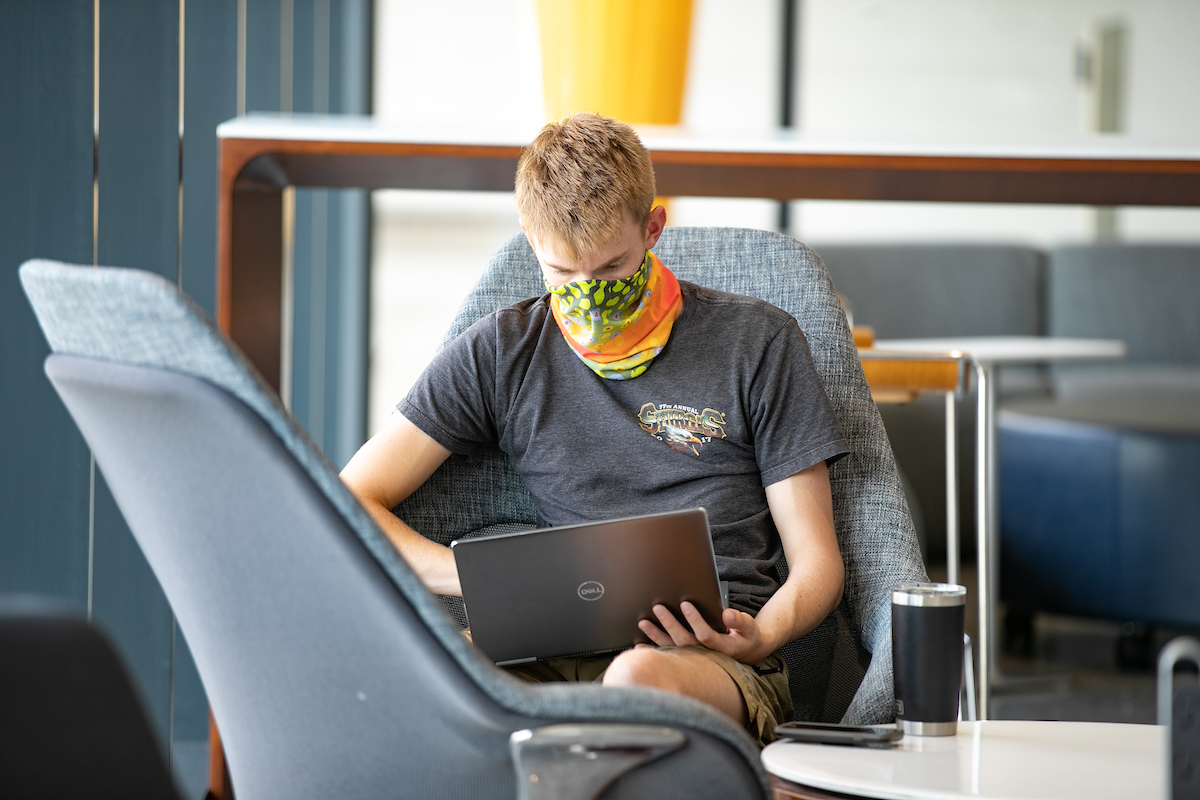 Student wears mask in Glass Hall.