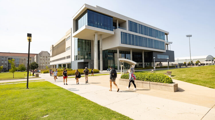 Students walking in front of Glass Hall.