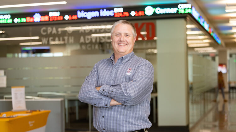 Jeff Jones stands in front of stock trading lab in Glass Hall.