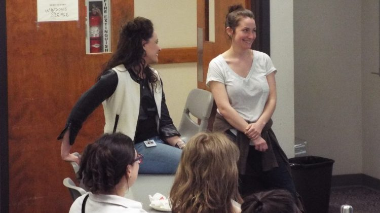 Karen Bolda, left, talks to students.