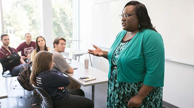 Faculty lecturing in a classroom