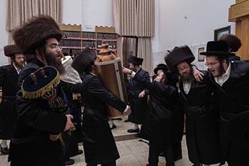 Men participating in a Simchat Torah celebration