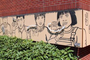 Mural at Washington School for the Deaf showing sign language