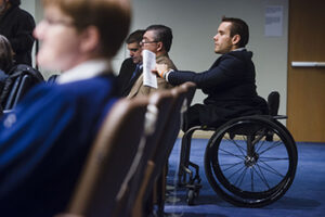 Photo of International Day of persons with disabilities event attendee listens to event speaker
