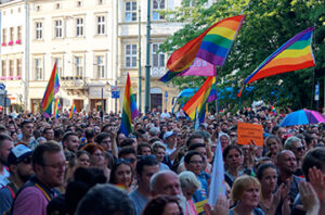 Photo of a LGBTQ solidarity demonstration with people holding pride flags