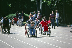 Image of two men participating in wheelchair races