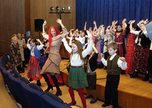 Photo of children dancing and singing during a day of tolerance event