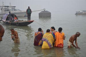 Photo of Hindu devotees taking a holy dip in the river Ganga