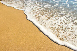 Photo of sand and water at the beach