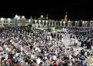 Large group of people gathered for food after fasting for Ramadan