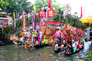 Dragon Boat Festival in Haiwei, Ronggui 2011, boats on the water with a lot of people and brightly colored flags