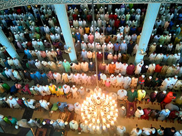 Photo taken from above looking down on a prayer service.