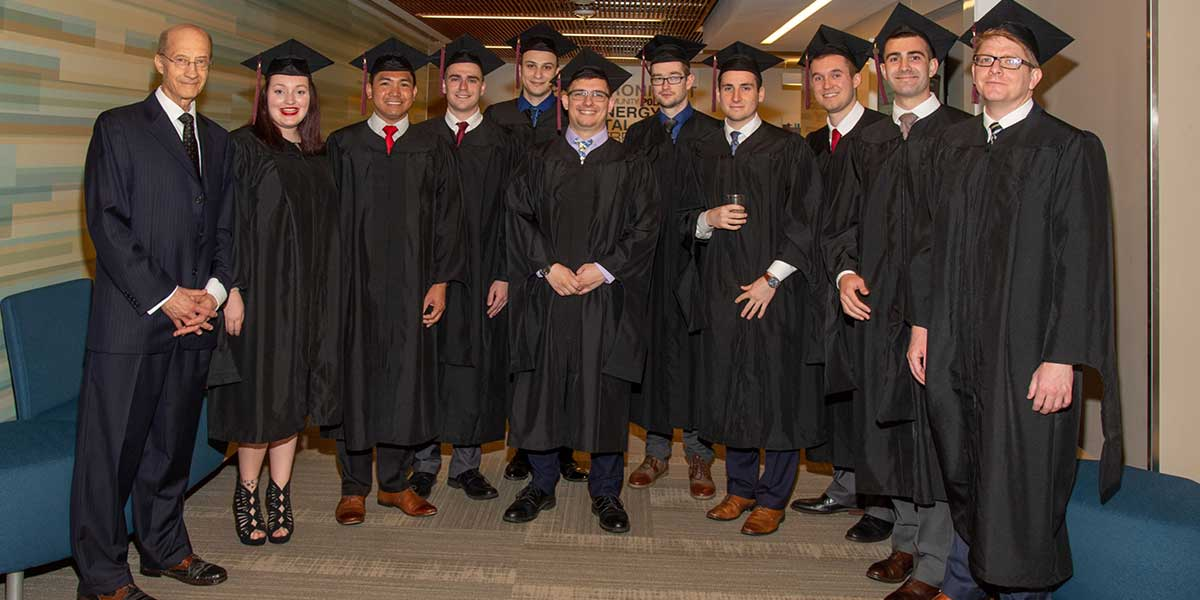 John Rose and DSS graduates at commencement ceremony.