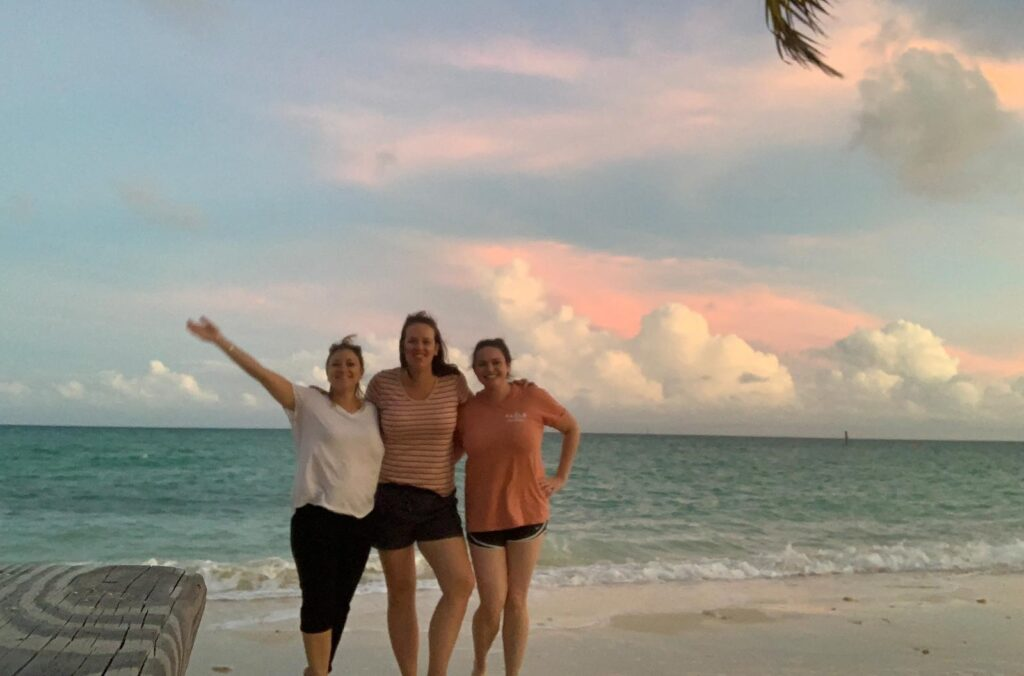 Cara and her team on the beach in the Bahamas