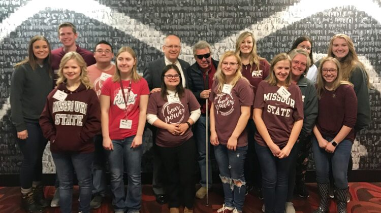 Bear POWER students and staff take a picture with Missouri State University President Clif Smart.