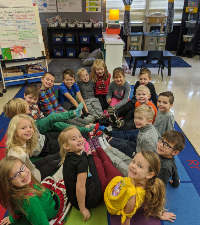 Michelle Slominsky's class gathers in a circle on the floor of her classroom.