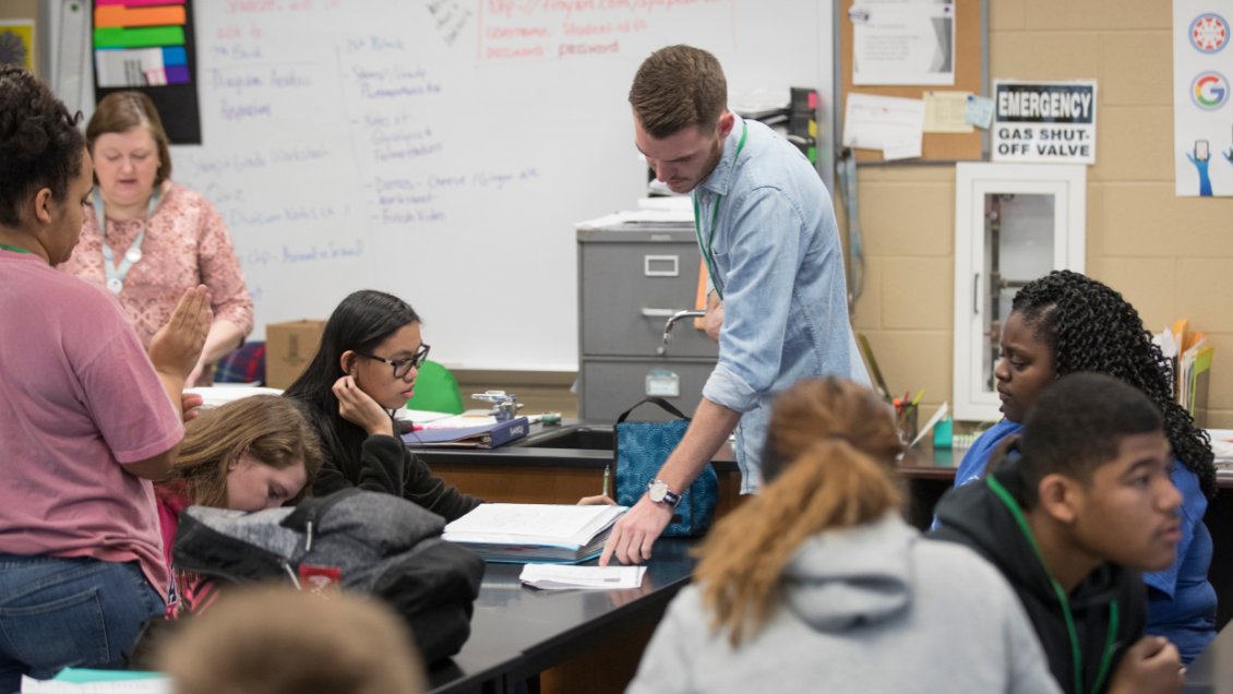 A Missouri State practicum student visits with high-schoolers in this 2017 photo.