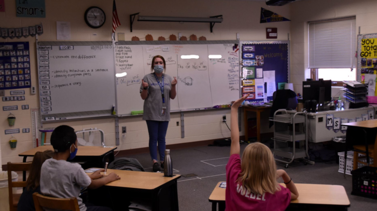 Kaitlin Voss teaches at the front of her classroom at the Kansas School for the Deaf.