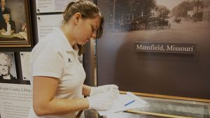 Student viewing artifacts at the Wilder Museum