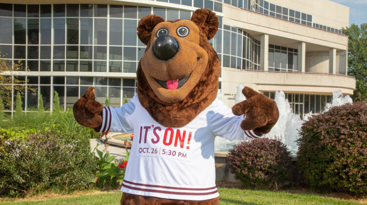 Boomer Bear displays his It's On! shirt.