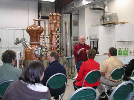 Dr. Karl Wilker talking to the workshop participants about the process of making grappa or grape brandy.