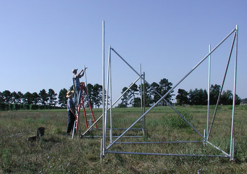 Researchers construct rainfall simulators for their experiment.