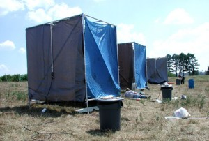 The researchers simulate rainfall under the tarps and collect the surface water runoff generated in the simulations.