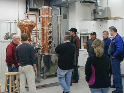 Participants at the distillation workshop learning the technique.