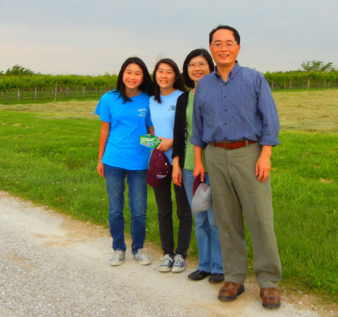 The Hwang family from left to right are Anna, Alice, Li Ling Chen and Dr. Hwang. They have been collecting grape leaves.